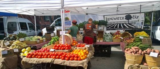 Farmers market display of local, fresh, organic vegetables and fruit.