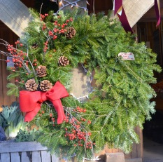balsam wreath pinecones red berries square