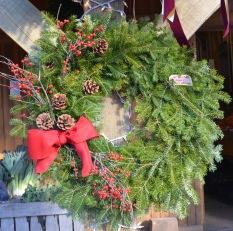 balsam wreath pinecones red berries square
