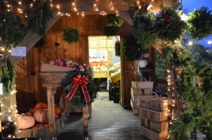 farmstand decorated for christmas night