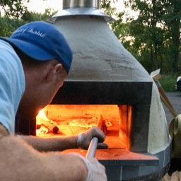 kevin working the pizza oven