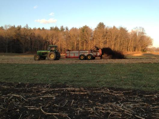 compost spreading winter green tractor